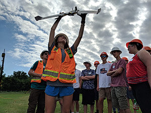 woman holding up a drone